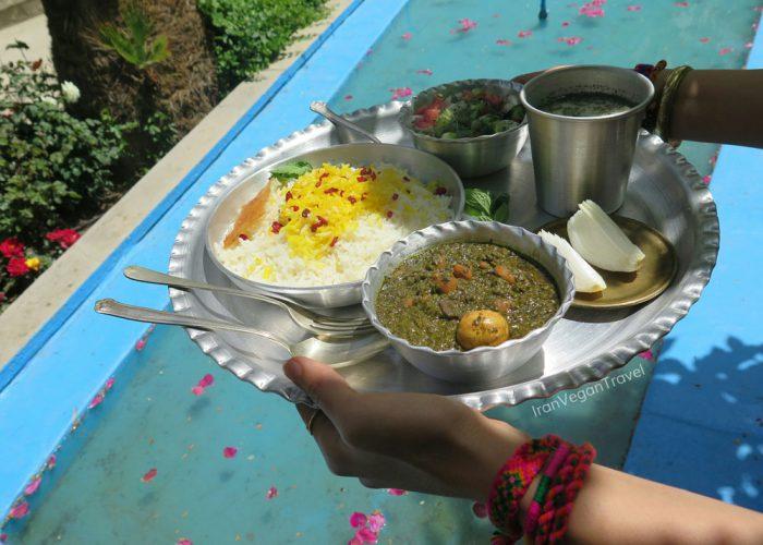 Vegan ghormeh sabzi - a Persian vegetable stew along with Persian saffron rice and tahdig