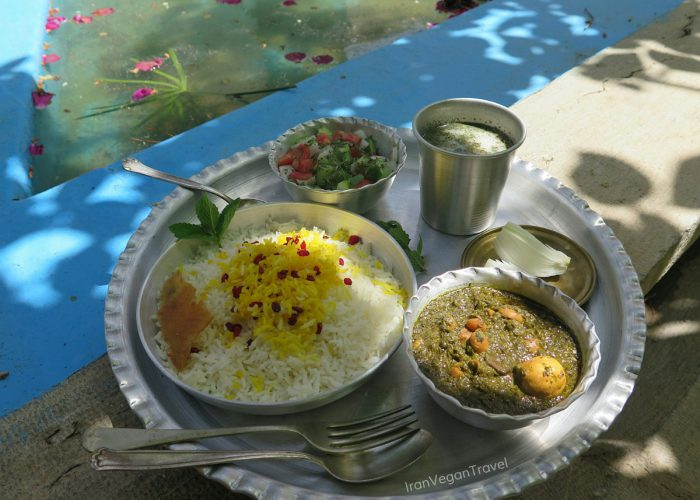 cooking vegan ghormeh sabzi on Iran food and culture tour